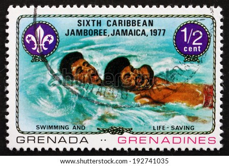 GRENADA AND GRENADINES - CIRCA 1977: a stamp printed in Grenada shows Swimming and Life Saving, 6th Caribbean Jamboree, Kingston, Jamaica, circa 1977 - stock photo