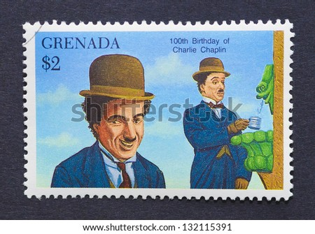 GRENADA - CIRCA 1990: a postage stamp printed in Grenada showing an image of Charles Chaplin, circa 1990. - stock photo