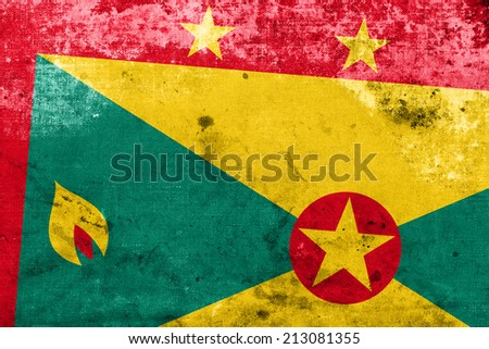 Grenada Flag with a vintage and old look - stock photo