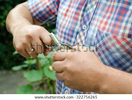 grenade in his hand. Social poster - stock photo