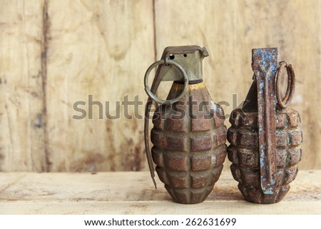Grenade on old wood for background and texture - stock photo