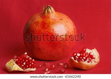 Grenades, and two slices of garnet - stock photo