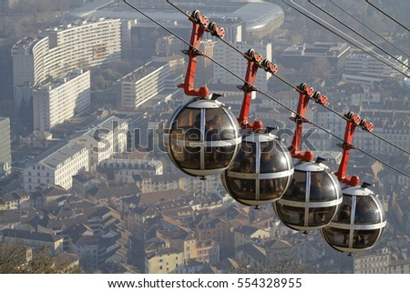 "GRENOBLE, FRANCE, December 28, 2016 : The Bastille is an ancient series of fortifications overlooking Grenoble, and destination of the Cable Car, system of egg-shaped cable cars known as ""Les Bulles"""