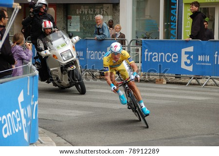 """GRENOBLE, FRANCE - JUN 8: Professional racing cyclist Alexandre Vinokourov rides UCI WORLD TOUR """" CRITERIUM DU DAUPHINE LIBERE"""" third stage time trial on June 8, 2011 in Grenoble city, Isere, France. - stock photo"""