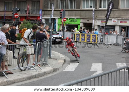 """GRENOBLE, FRANCE - JUN 3: Professional racing cyclist Cadel Evans rides UCI WORLD TOUR """"CRITERIUM DU DAUPHINE LIBERE"""" time trial on June 3, 2012 in Grenoble, France. Luke Durbridge wins the stage. - stock photo"""