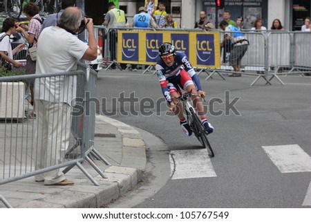 """GRENOBLE, FRANCE - JUN 3: Professional racing cyclist Gert Dockx rides UCI WORLD TOUR """"CRITERIUM DU DAUPHINE LIBERE"""" time trial on June 3, 2012 in Grenoble, France. Luke Durbridge wins the stage - stock photo"""