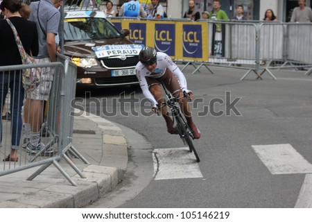 """GRENOBLE, FRANCE - JUN 3: Professional racing cyclist J.C. Peraud rides UCI WORLD TOUR """"CRITERIUM DU DAUPHINE LIBERE"""" time trial on June 3, 2012 in Grenoble, France. Luke Durbridge wins the stage - stock photo"""