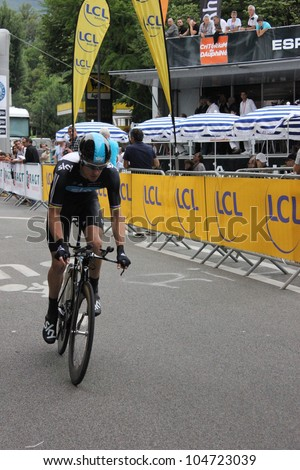 """GRENOBLE, FRANCE - JUN 3: Professional racing cyclist Michael Roggers rides UCI WORLD TOUR """"CRITERIUM DU DAUPHINE LIBERE""""  time trial on June 3, 2012 in Grenoble, France. Luke Durbridge wins the stage - stock photo"""