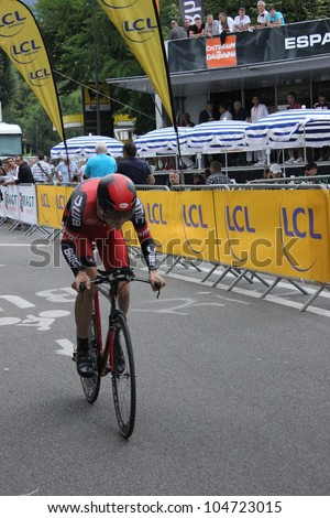 """GRENOBLE, FRANCE - JUN 3: Professional racing cyclist T. Van Garderen rides UCI WORLD TOUR """"CRITERIUM DU DAUPHINE LIBERE""""  time trial on June 3, 2012 in Grenoble, France. Luke Durbridge wins the stage - stock photo"""