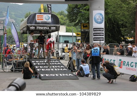 """GRENOBLE, FRANCE - JUN 3: Professional racing cyclist Yohan Bagot rides UCI WORLD TOUR """"CRITERIUM DU DAUPHINE LIBERE"""" time trial on June 3, 2012 in Grenoble, France. Luke Durbridge wins the stage. - stock photo"""