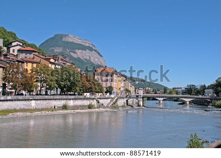 Grenoble. River and bridge with mountain in background.