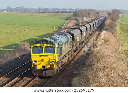 GRETNA, UK - JANUARY 22: A Freightliner operated coal train heads an empty train back to the coal colliery on January 22, 2015 in Gretna. FLT founded in 1995 has an operating revenue of approx �£360Mn  - stock photo