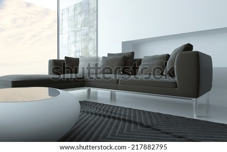 Grey and white minimalist sitting room interior with a stylish modern coffee table and upholstered lounge suite in front of floor to ceiling glass windows - stock photo