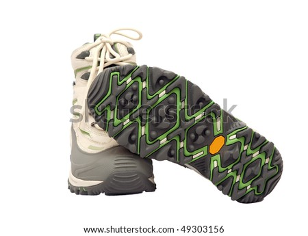 Grey and white new winter hiking boots - stock photo
