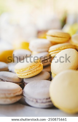 Grey and yellow macaroons background - stock photo