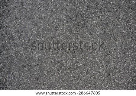 Grey asphalt texture: closeup - stock photo