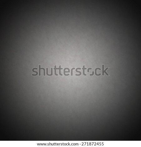 Grey background or grey paper with bright spotlight on black background texture - stock photo