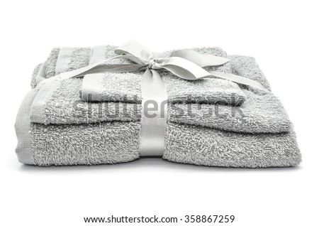 Grey bath towels on Isolated white background - stock photo