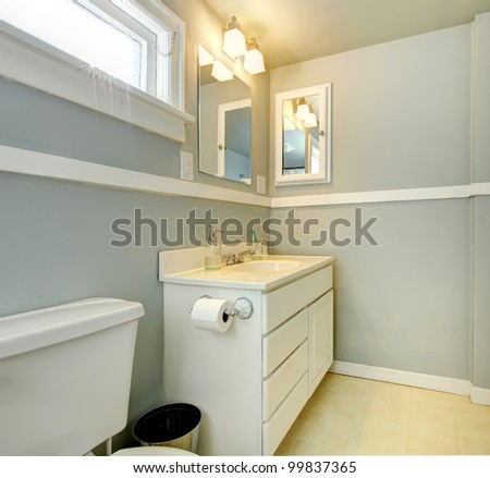 Grey bathroom with white simple cabinet and toilet. - stock photo