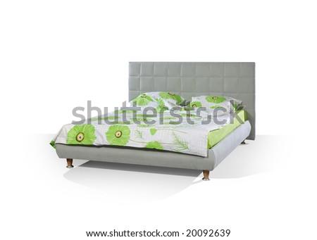 grey bed on white floor - stock photo