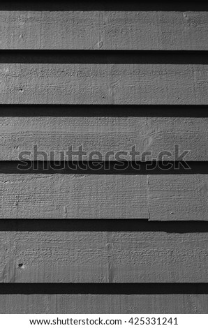Grey black and white painted barn wood rustic pine planks traditional norwegian siding background pattern closeup. Space for text. lettering, copy. - stock photo