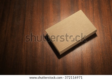 Grey book on the table - stock photo
