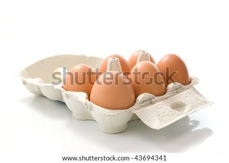 Grey Box of eggs on white background - stock photo