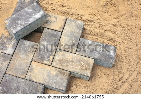 Grey bricks on a construction site of a new pavement - stock photo