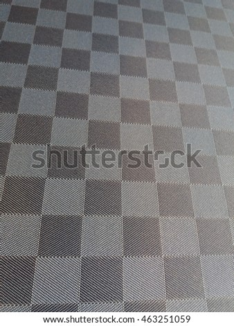 Grey checkered surface useful as a background