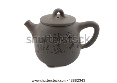 grey chinese teapot with hieroglyphic ornament isolated on white