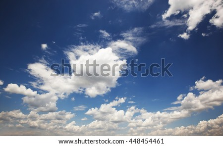 Grey clouds in the blue sky - stock photo