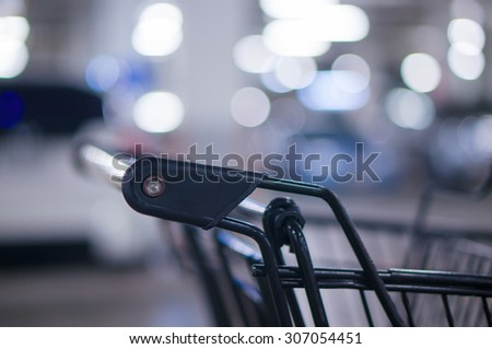 Grey color shopping cart on underground car park in supermarket
