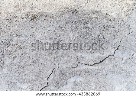 Grey concrete wall with traces in close-up. - stock photo