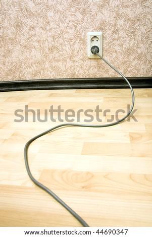 Grey cord on the laminated floor - stock photo