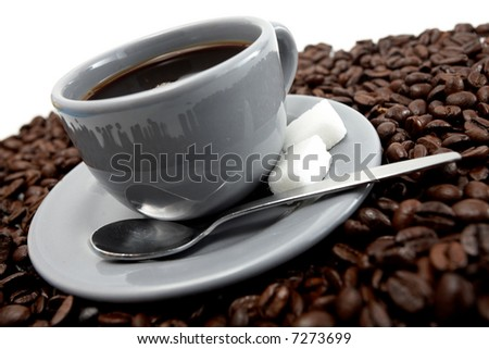 Grey cup of coffee with beans over white background - stock photo