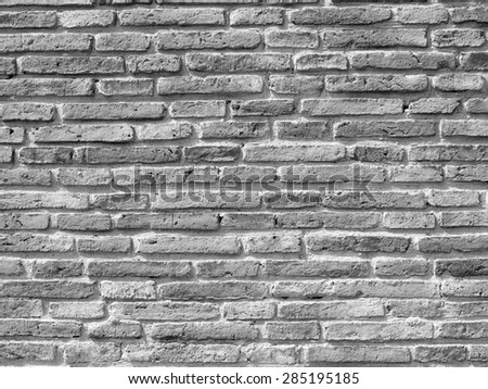 Grey dirty brick wall - stock photo