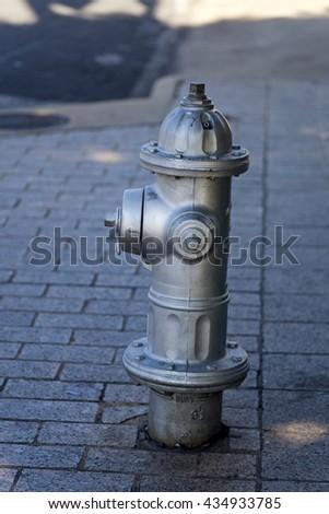 Grey fire hydrant in Austin, Texas - stock photo