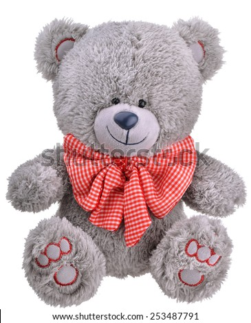 Grey furry teddy bear with red bow isolated on white background - stock photo