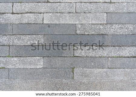 Grey granite brick stone street road walkway pattern - stock photo