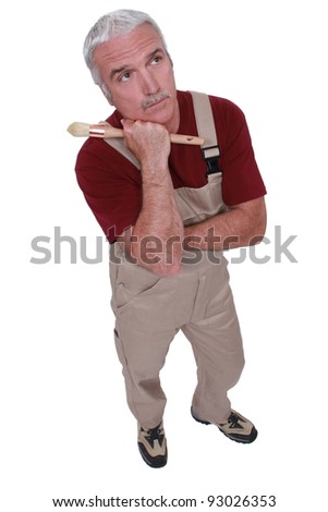 Grey-haired decorator thinking - stock photo