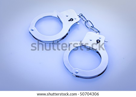 Grey handcuffs isolated on white background - stock photo