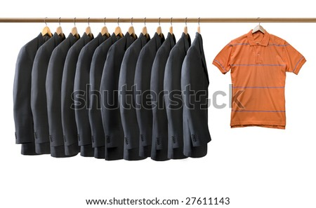 Grey jackets and an orange t-shirt hanging on coat hangers isolated - stock photo