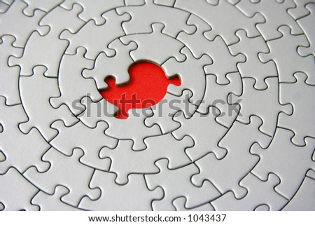 grey jigsaw with one missing piece - focus is on the hole