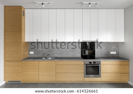 Grey Kitchen Wooden Cabinets Granite Worktop Stock Photo Royalty - Grey kitchen walls with wood cabinets