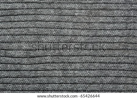 Grey knitted fabric background - stock photo