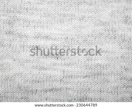 Grey knitted fabric textured background - stock photo
