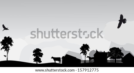 grey landscape with trees and village - stock photo