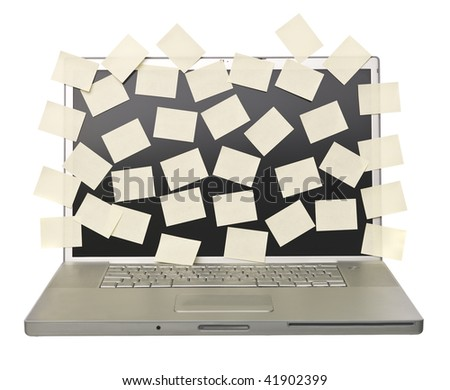 Grey laptop overflowed with empty post-its isolated on a white background - stock photo