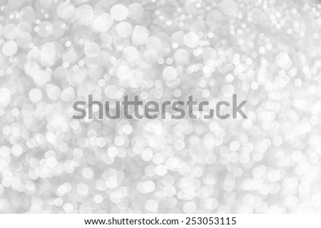 Grey light festive bokeh defocused abstract background. - stock photo