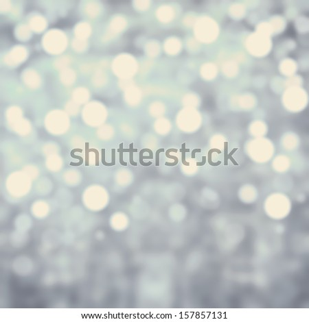 Grey Lights Festive background. Abstract Christmas  twinkled  bright background with bokeh defocused silver lights  - stock photo
